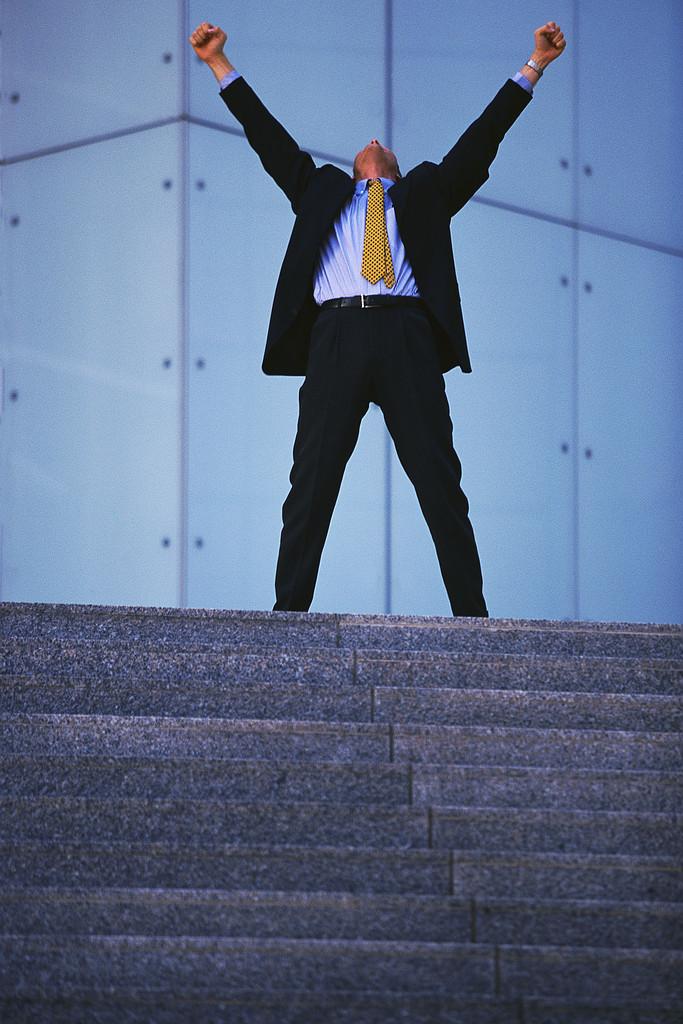 success, man raising arms